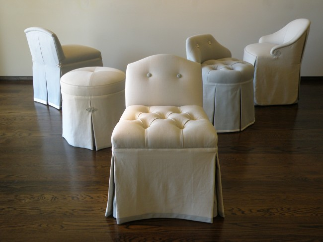 Here is the collection of petite chairs that are perfect for perching rather than lounging in the bath. Some have tufted seats and others have deep pleats with a contrasting color on the iverted part.