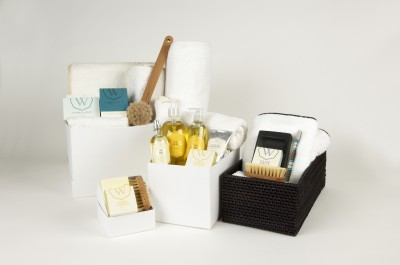 Towels, soaps, baskets, bath brushes and candles. All of the amenities for a spa at home.