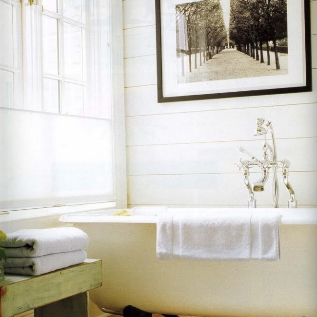 Photographs are always good bath art, although I would not put my vintage Steichen in there. Humidity could create havoc with the fragile print.