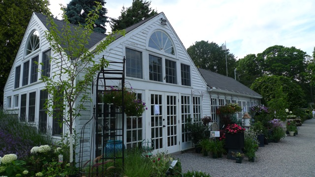 The White Flower Farm shop with a lovely assortment of plants at the entrance.