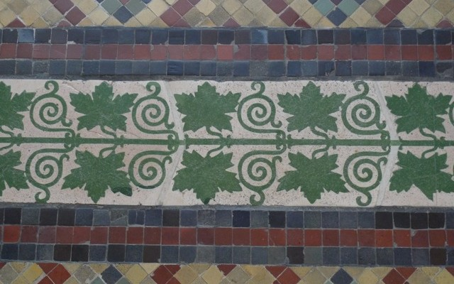 Neues Museum. A complicated organic border in bright greens.