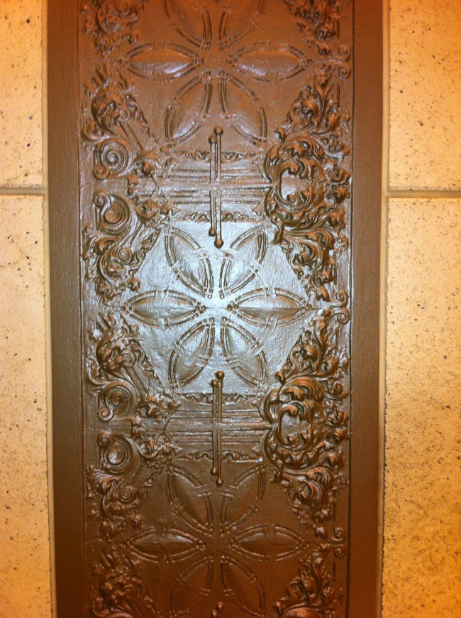 In typical Louis Sullivan fashion, a number of embossed metal panels are embedded in the stone walls.