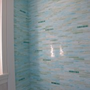 An early stage installation shot—a freshly grouted wall in the bathtub.