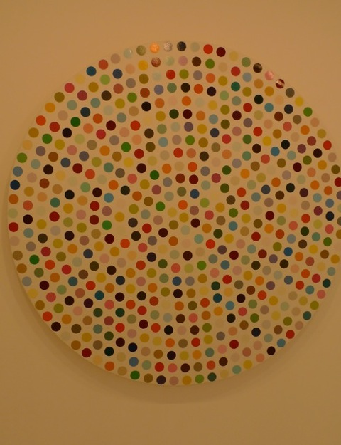 "A Damien Hirst painting of ""Spots"" created on a circle canvas.  Gagosian Gallery, Paris."