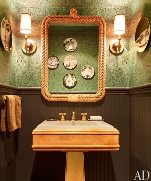 Nate Berkus was ahead of the curve when he papered this powder bath in a green overall malachite-like  pattern. It is stunning with brass accents and a dark brown wainscott. This really makes a statement. (As seen in Architectural Digest November 2012.)