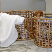 These open weave baskets made of the dried stalks of the Water Hyacinth plant are hand woven by skilled craftsmen. Their durable leather handles make them the perfect container for carrying laundry or towels to the beach.  The smaller containers are great in the kitchen.