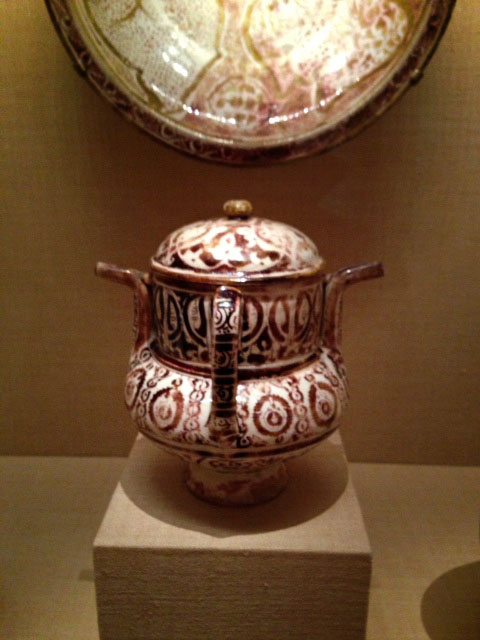 This posset pot is similar to those created much later in Delft. The sepia colored decoration is beautifully painted and symmetrical.