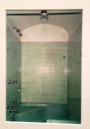 Square tubs were all the rage in the small baths of the 30's.  This one in mint green with a built in seat was quite fancy.  Matching green tile with pink trim is very much of the period.