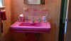 Bubble gum pink in a master bath of an elegant  Tudor house in NY. Certainly not a 21st century point of view.