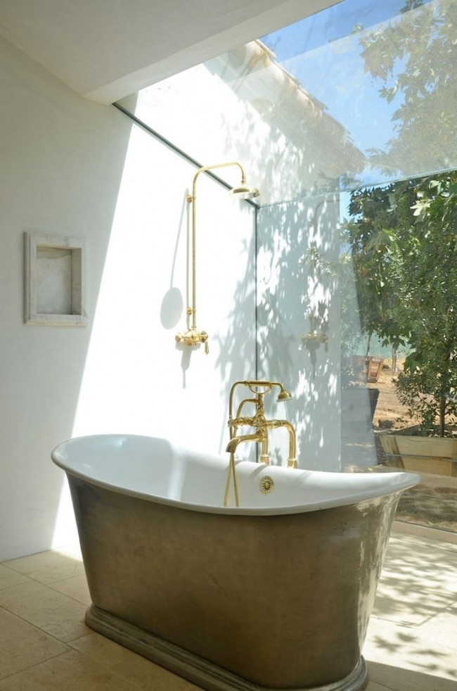 Steve and Brooke Gianetti's new bath at Patina Farm. Warn sunshine, pours through the window with a view of the garden beyond.
