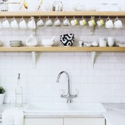 "Simple bright white ""subway"" tile is a good choice for this space. It is a neutral background for everyday essentials."