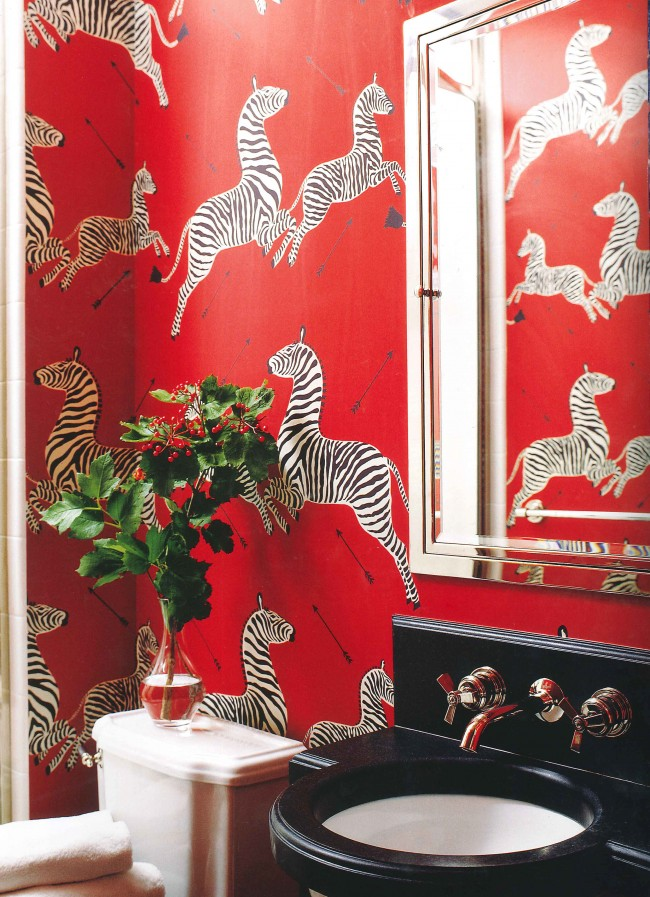 Prancing zebras make a bold statement in this tiny bath. Wall mounting the Aero lavatory faucet is a space saving gesture.