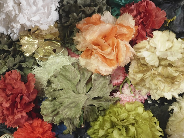 Drawers full of fanciful silk blooms.