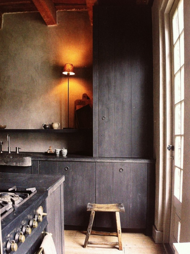 A medium to dark toned wood has great texture. Combined with the rough textured walls, the room feels friendly and warm.
