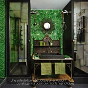 I am not sure what this metal piece was used for before it became a really cool vanity.  It's presence is enhanced with the great wallpaper. This is a charming and vibrant environment.
