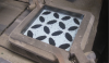 After the color has been squeezed into the die, and before the cement layer is added.