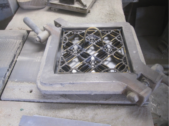 A mold for making cement tile.  The tile is built updsdie down.