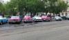 Love these pink and white '50s cars.