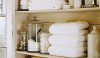 A good fold for towels and containers for bath amenities keep the linen closet in order.