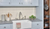 Even a simple white backsplash can make a kitchen feel clean and new.